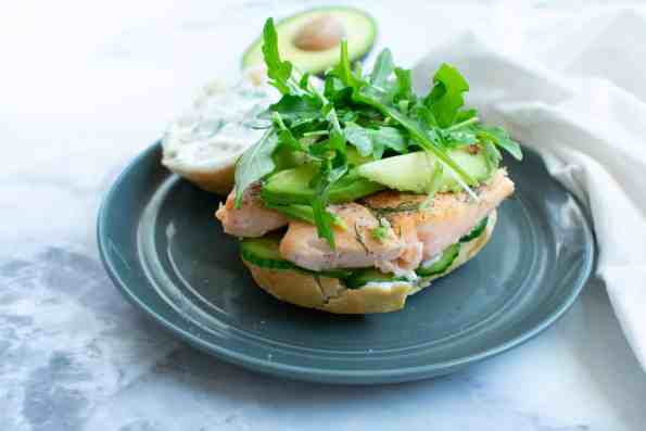 salmon sandwich on a gray plate