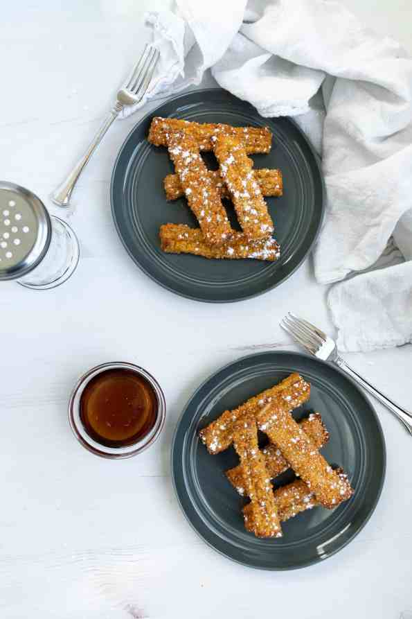 french toast sticks on a gray plate and white background