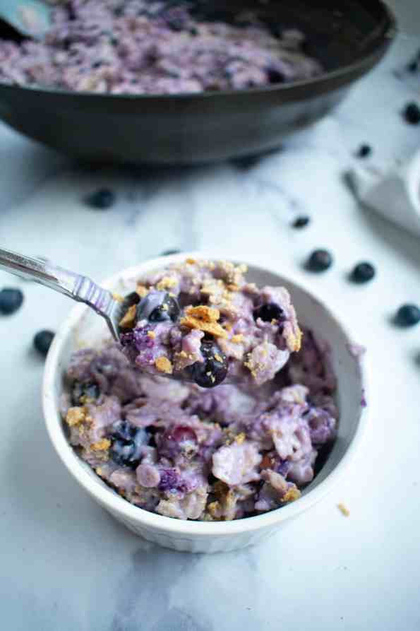 blueberry oatmeal in a bowl with spoon