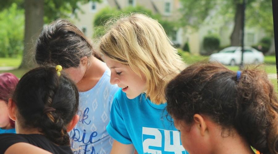 volunteers play with children