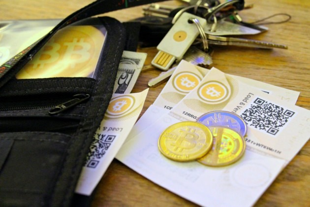 bitcoin-paper-coin-and-USB-wallets-630x420