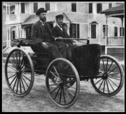 Charles (left) and Frank Duryea in their 1893 Duryea gasoline car. From Outing magazine Vol 51 Pub. 1908