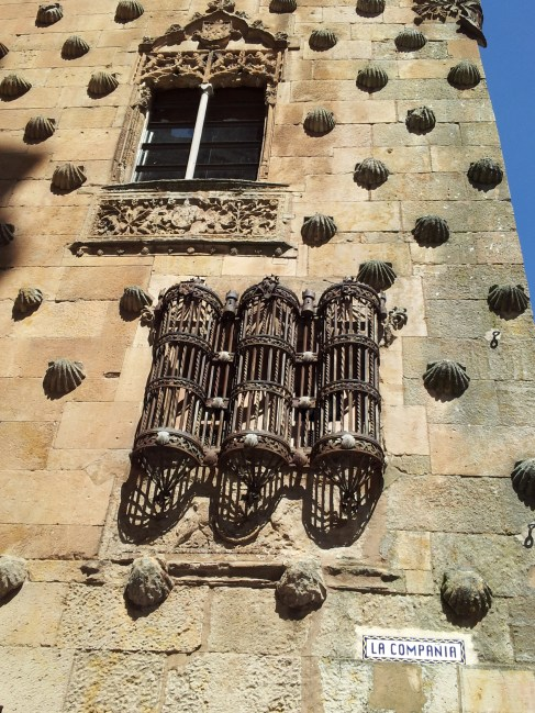 La Casa de las Conchas - a house with over 500 shells embossed on the wall of the building.  This image alos shows the ornate windows