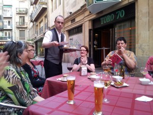 Beer being served in a small bar in Spain