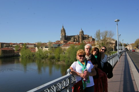 4 teachers on the bridge with the cathedral spires in the background