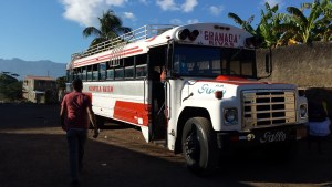 red and white public service bus in Granada,  Nicaragua