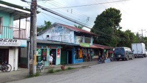 Street in Puerto Jimenez, shops selling gifts and soyuvenirs and a dvd rental place
