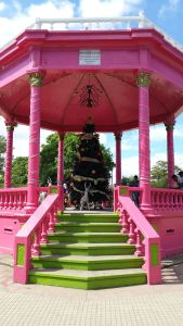 very pink bandstand with green steps