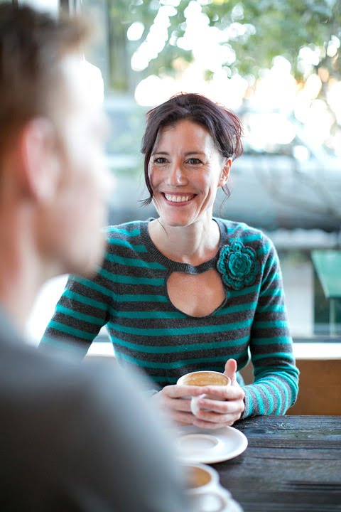 Image of lady having tea conversation starters
