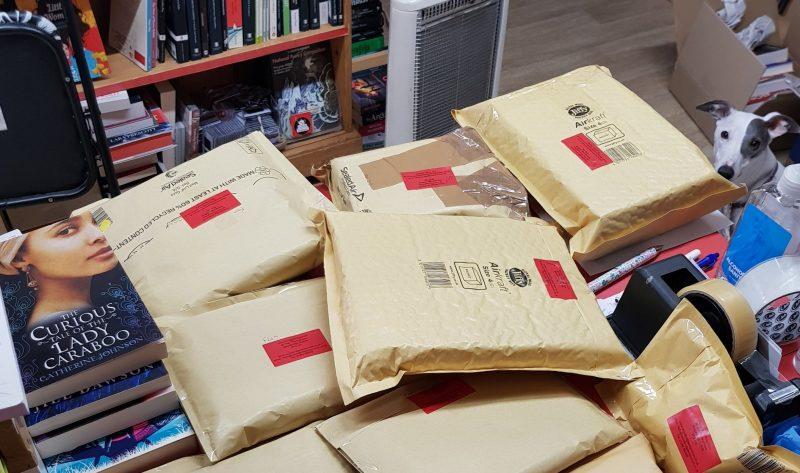 Packing books at Woodbridge Emporium