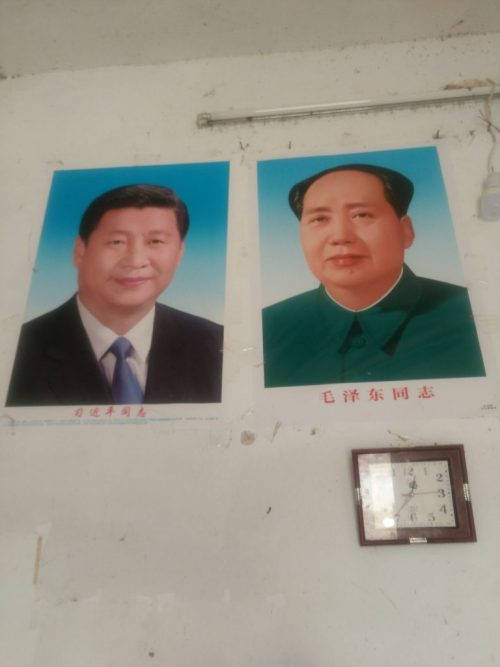 Portraits of Xi and Mao were hung on the wall of a Christian's house.
