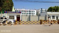 """Qapqal Xibe county 3rd Middle School """"transformation through education"""" camp's front entrance and constable area, post-repurposing"""