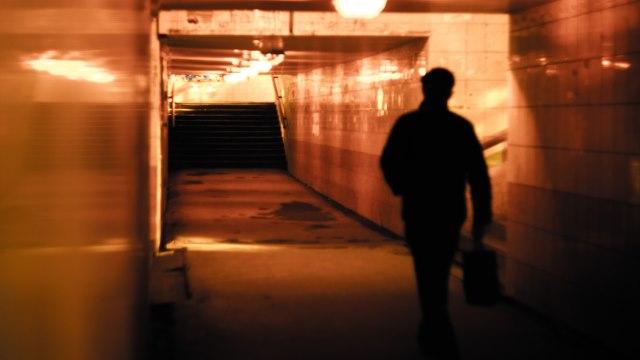 man walk in the underground tunnel