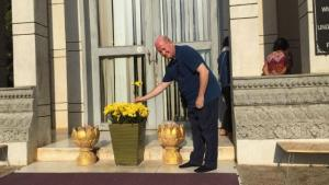 Bitter Winter's editor-in-chief, Massimo Introvigne, offering flowers at the stupa in the Choeung Ek killing fields