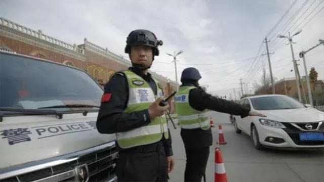 Police conducting inspections on the street