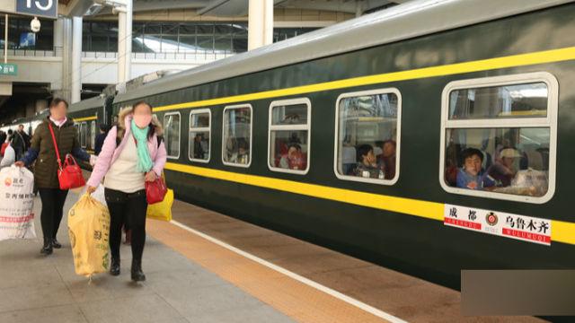 two uyghur women boarding the train