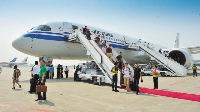 People disembarking from an airplane
