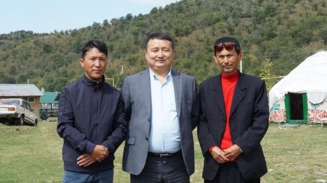 Bagashar Malik (left), activist Serikzhan Bilash (center), and supporter Tursynzhan Esenali (right)