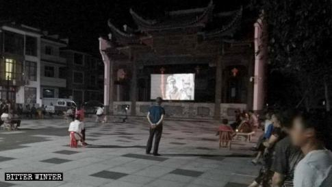 Communist propaganda film is shown in a Guangxin district square in Shangrao.