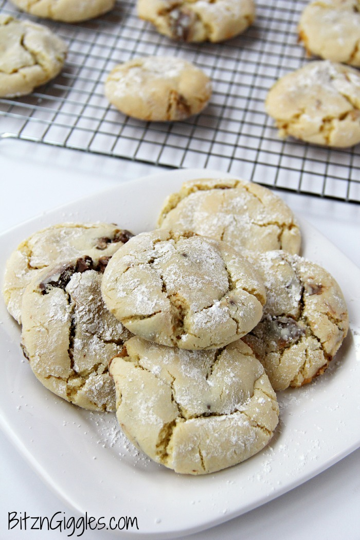 Candy Bar Cookies - Soft and simple cake mix cookies filled with chocolate candy bar pieces and rolled in powdered sugar.