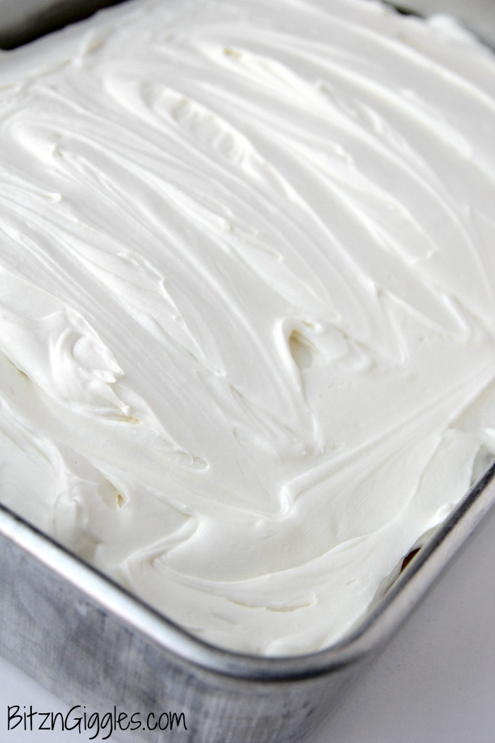 Coconut Poke Cake - A fluffy, moist cake infused with Cream of Coconut and topped with a light and airy cream cheese frosting!