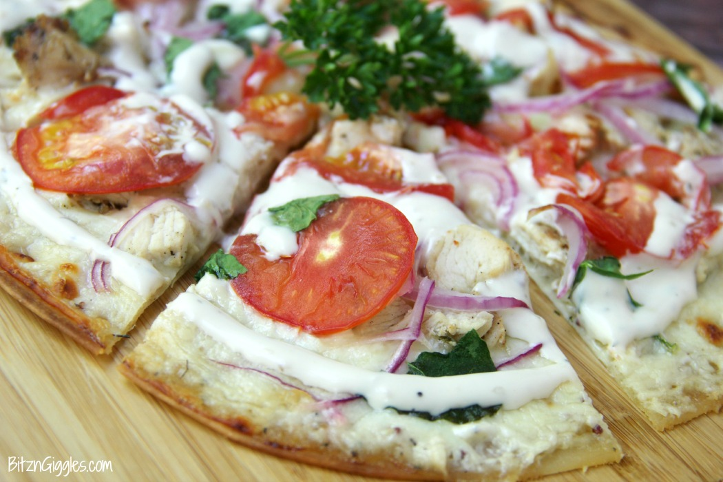 "Chicken Ranch Tortilla Pizza - A quick and delicious ""skinny"" pizza with sprinkles of grilled chicken and fresh vegetables, bursting with mouth-watering garlic and ranch flavors!"