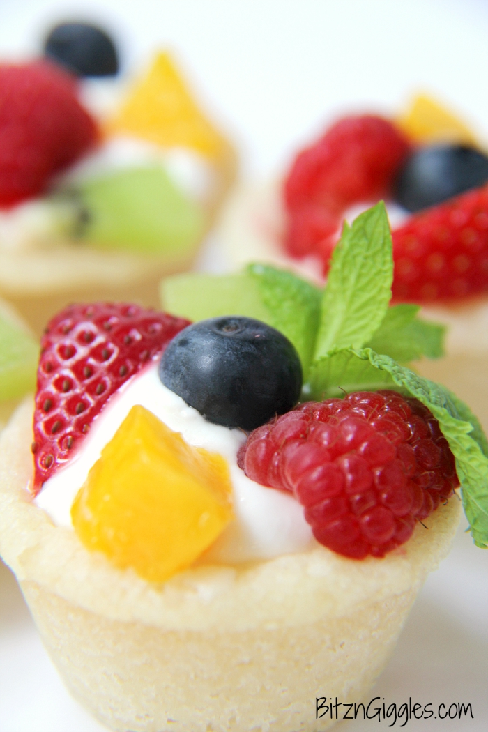 Sugar Cookie Fruit Cups - A bite-sized sugar cookie cup topped with fresh fruit, perfect for parties and gatherings!