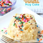 Easy Vanilla Mug Cake - Ready in 90 seconds! This mug cake is delicious, moist and topped with a lovely vanilla icing that soaks into the cake and infuses it with sweetness!