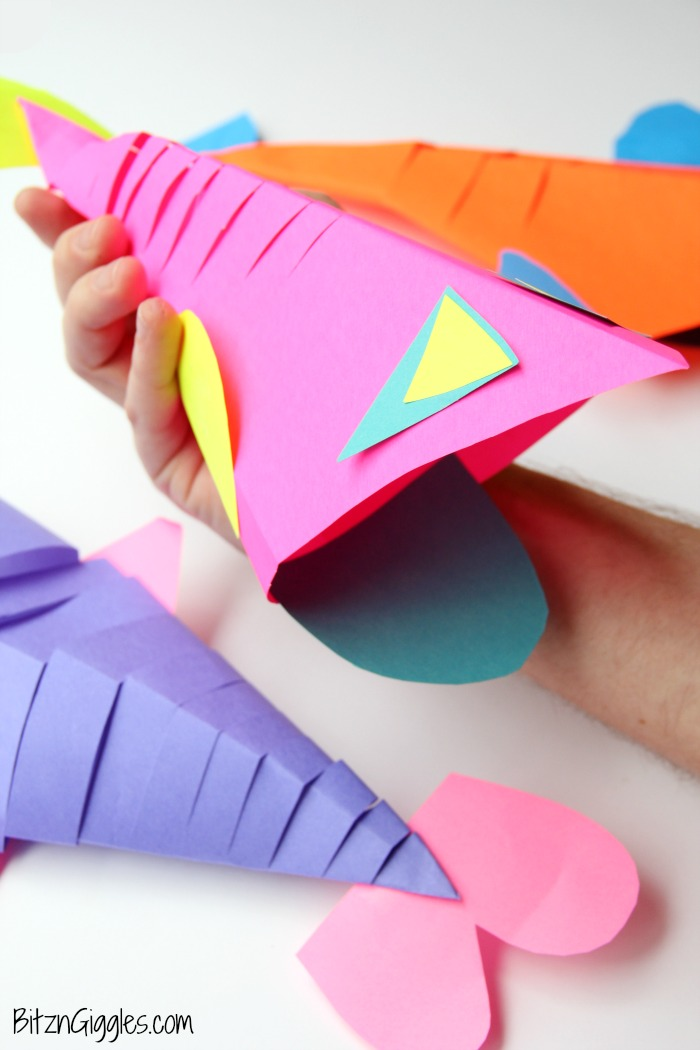 "Slinky Fish Craft - All you need is construction paper, scissors and glue stick for this fun and colorful kids craft! The slinky ""cut"" makes the fish flexible almost like it's swimming!"