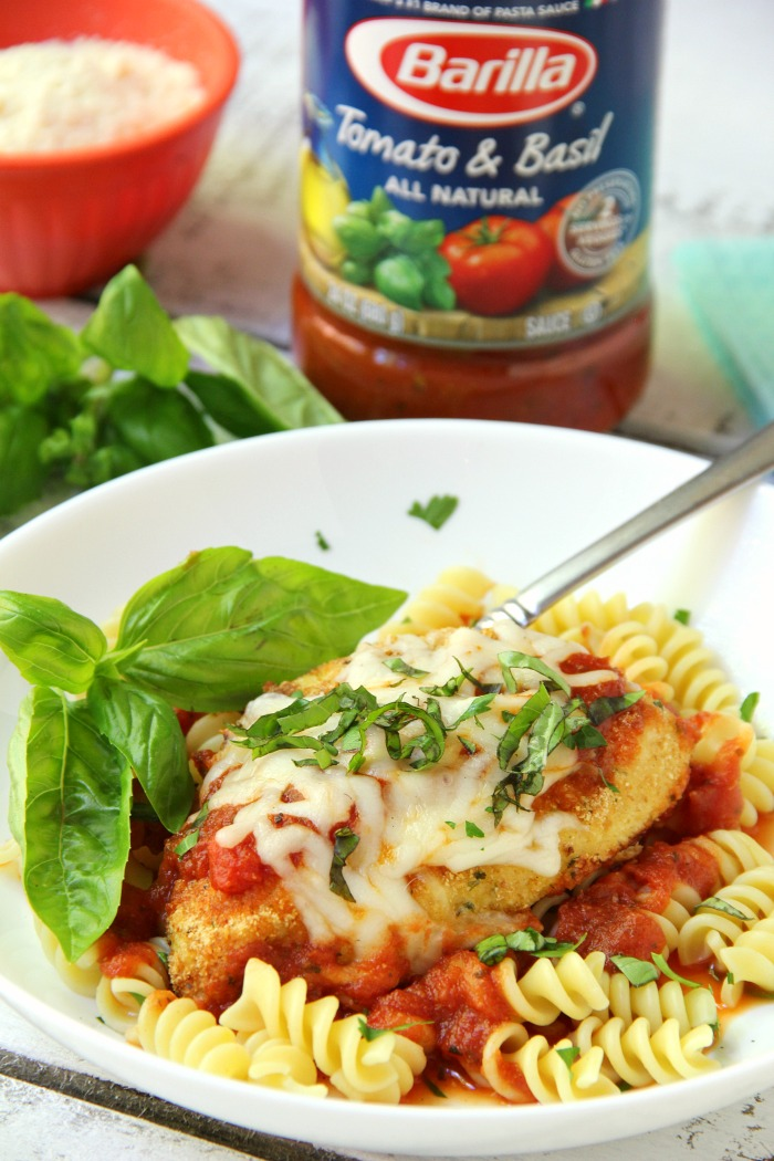 Mozzarella Basil Chicken -a delicious twist on traditional chicken parmesan. The chicken cutlets are breaded and baked, creating delicious and moist chicken to serve over pasta and sauce.