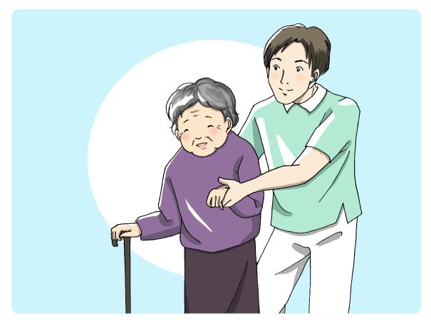 おばあさんの介護をする男性