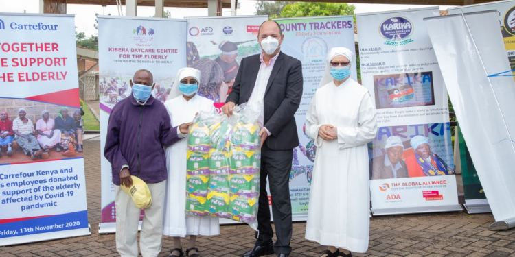 Franck Moreau, Country Manager of Carrefour Kenya at Majid Al Futtaim Retail handing over donation to Mzee Joseph Mujoka (first left), Sr. Teresiah of Jesus & Sr. Antony of Mary (right), all of Nyumba ya Wazee at the Little Sisters Of The Poor, Nairobi - Bizna Kenya