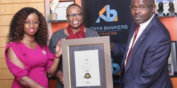 Monica Chege, Credit Bank's Senior Manager, Marketing and Communications (left), and Credit Bank's Contact Centre and Customer Experience Manager, Judith Wanjala (centre), receive the 1st Place - Best in Tier 3 certificate Kenya Bankers Association's CEO, Dr Habil Olaka, during the unveiling of KBAs Customer Satisfaction Survey. For the third year running, Credit Bank was voted Best in Tier 3 in Customer Responsiveness and Digital Experience - Bizna Kenya