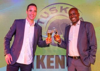 East African Breweries Limited (EABL) Marketing & Innovations Director Graham Villiers-Tuthill (Left) and Kenya Breweries Limited (KBL) Managing Director John Musunga during the launch of the Kenya Milele Campaign at K1 Club House in Nairobi - Bizna Kenya