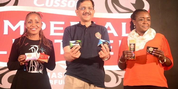 From Ruth Wangombe, Imperial Leather Brand Manager (left) Sekar Ramamoorthy PZ CUssons Managing Director (center) and Hafsa Authur PZ CUssons Head of Marketing display some of the new variants for men during the official launch - Bizna Kenya