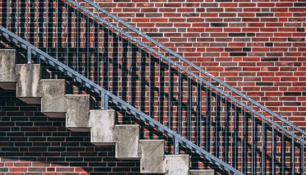 concrete steps against brick wall
