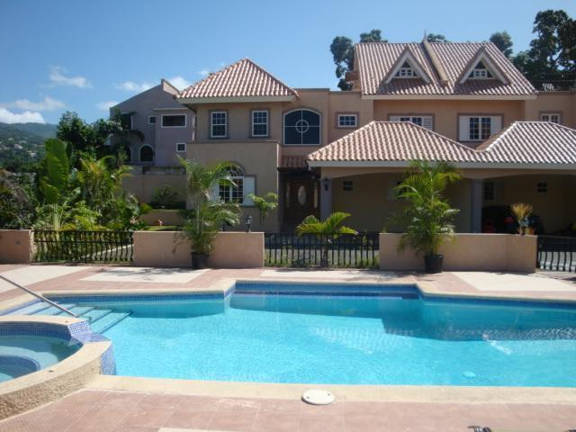 Fully furnished, tri-level 4,600 sq ft townhouse in lovely garden setting with waterfall, Koi pond and pool
