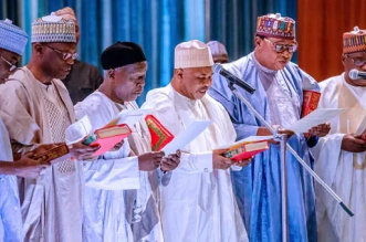 Buhari Swears-in New Members