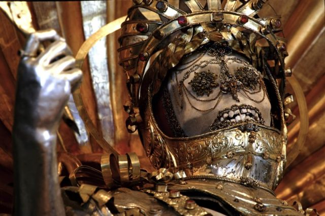 - Bürglen, Switzerland, detail of the skull St. Maximus inside armored helmet. One of two surviving skeletons of saints taken from the Roman Catacombs as presumed martyrs and decorated in armor in Switz -