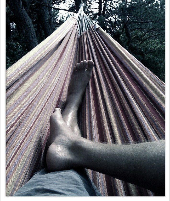 Image of a person's feet in a hammock.