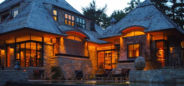 I just love the glow of a glass house in the evening – a modern copper clad Missouri home