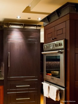 Modern Dark Wood Kitchen with Steel Crown Moulding
