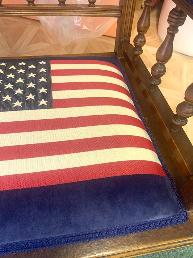 A chair reupholstered in a flag