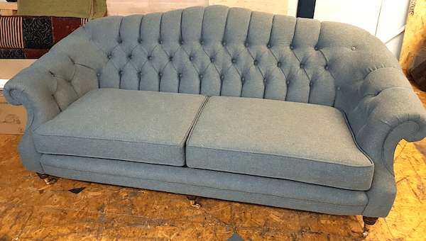 Folded button back sofa