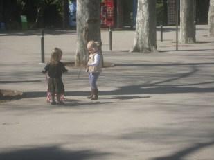 Nora and Eva reunited- Nora shows Eva her stroller and Eva shows Nora a stick.