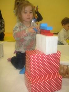 Nora building towers at Toddler Sense.