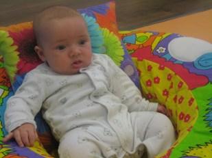 Max watching Nora play at Toddler Sense.