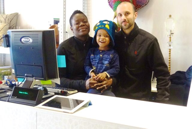 Husband-and-wife team Achuziem Maha-Sanchez and Lionel Sanchez, owners of peace & RIOT, with their son