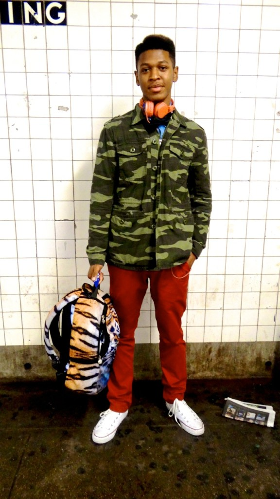 This friendly teen was just leaving school. We caught him waiting for the C train. He stood out from the rest of his schoolmates because he definitely was unafraid of showing his fashion sense through patterns and colors.