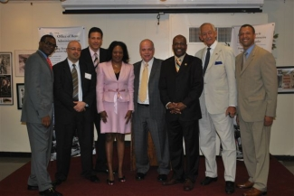 """From left to right: Woody Pascal, Deputy Commissioner Office of Rent Administration; Manny Burgos, Special Assistant to the Commissioner; Bruce Falbo, Bureau Chief of the Rent Information Bureau; Deneane Brown, Director, Upper Manhattan Borough Rent Office; Greg Fewer, Director of Policy Unit, ORA; Commissioner/CEO Darryl C. Towns; Assemblyman Herman """"Denny"""" Farrell; Richard White, Deputy Commissioner Tenant Protection Unit."""